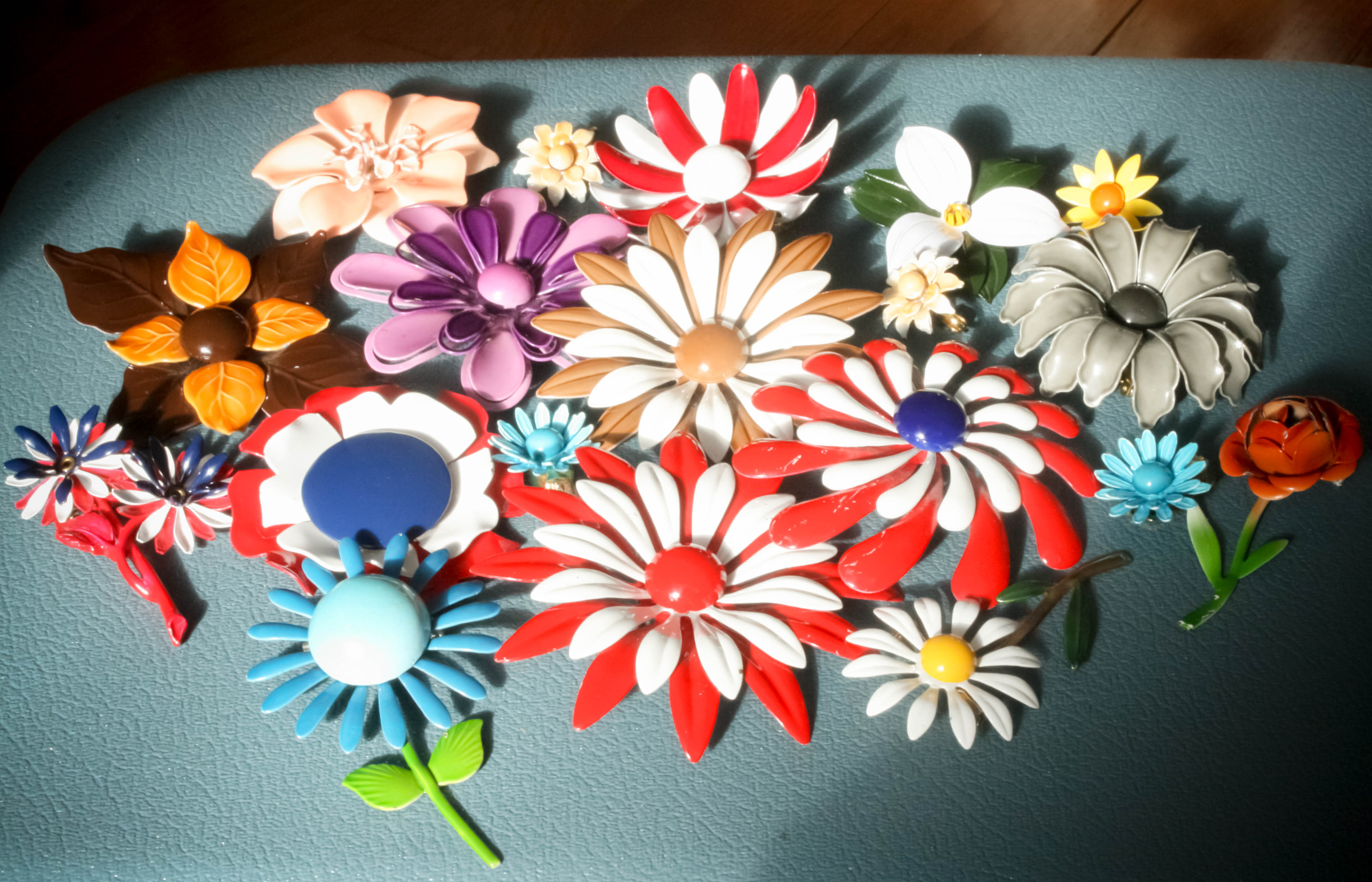 8db5cd80e7b Vintage enamel flower brooches are so much fun! They were a popular  accessory in the 1960s and have been making a huge comeback over the past  few years.